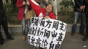 A man holds a banner saying &quot;Support Southern Weekly, boycott news censorship and return my freedom of speech&quot; outside the newspaper&quot;s headquarters in Guangzhou on 8 January 2013