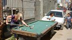 A pool table on a street in Alexandria, Egypt:  (Photo: BBC News website reader Ivan Rigney)
