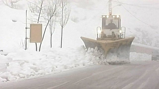 A snow plough shovels snow in Lebanon