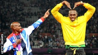 Mo Farah poses alongside Usain Bolt