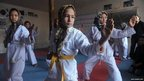 Afghan girls practice Taekwondo moves