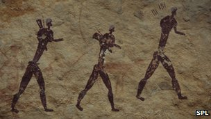 Rock painting of walking figures
