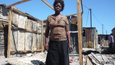 Zukiswa Gala in the ruins of her family's home in Khayelitsha