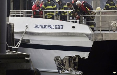 New York City firefighters walk the deck of the Seastreak Wall Street ferry in New York, 9 January 2013