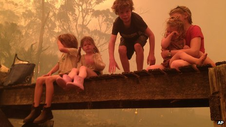 Photo of the Walker siblings as they prepare to enter the water to seek shelter under a jetty (4 January 2013)