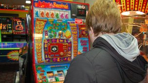 Person playing fruit machine