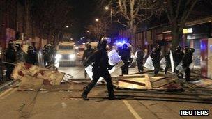 Police in riot gear in Belfast