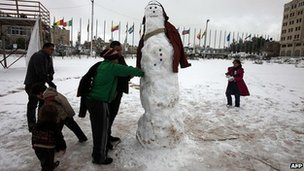 Children in Ramallah, West Bank, make a snowman. 10 Jan 2013