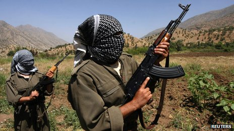 A picture taken in June 2007 of PKK fighters patrolling an area in the Iraqi part of the Qandil mountains near their headquarters on the Iraqi-Iranian-Turkish borders