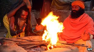 Holy men by a fire at the Kumbh Mela