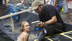 Naomi Watts on the set of The Impossible with director Juan Antonio Bayona