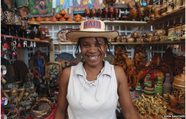 Woman wearing Haiti hat