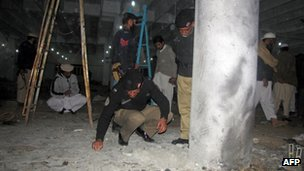 Police inspect the site of an explosion in north-west Pakistan