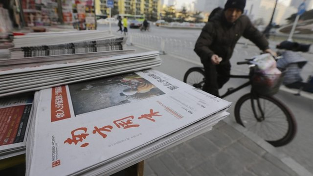 A stack of the Southern Weekly are left on display at a newsstand in Beijing
