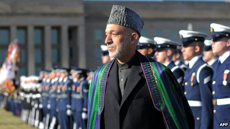 Afghan President Hamid Karzai reviews an honour guard at the Pentagon before his meeting with US Secretary of Defense Leon Panetta 10 January 2013