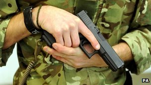 Royal Marine holds Glock 17 9mm pistol
