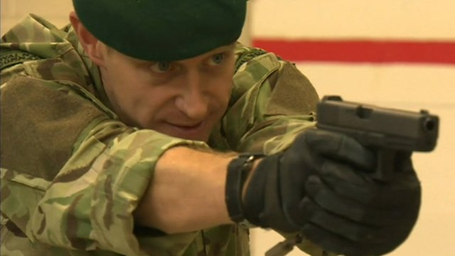 Soldier aiming pistol