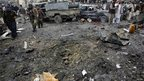 Bomb crater at a market in Quetta, 10 January 2013