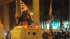 As councillors took the vote inside Belfast City Hall on 3 December 2012, a large loyalist protest gathered outside the building