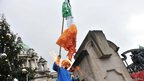 An Irish tricolour was burned by protesters at Belfast City Hall on 8 December