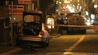 Police car in aftermath of petrol bomb attack