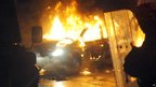 Car burns during riot