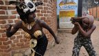 Two models portray a scene a violence on 7 January 2013 in the Central African Republic's capital, Bangui.