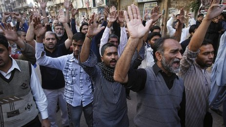 Shia Muslim men shout slogans during a protest rally organised by the religious group Majlis-e- Wahdat-e-Muslimeen in Karachi, 11 January 2013