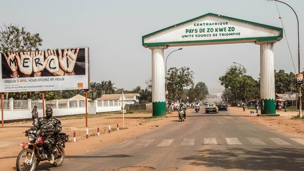 "An arch in the centre of Bangui which reads: ""Centreafrique, pays de zo kwe zo."""