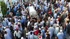 Pakistani relatives and journalists carry the coffin of dead reporter Saif ur-Rehman in Karachi on 11/1/13