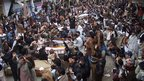 Pakistani Shia Muslims with the bodies of their relatives in Quetta on 1/11/13