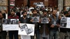 Journalists from the Balochistan Union of Journalists hold up photos of their dead colleague Imran Sheikh in protest in Quetta on 11/1/13