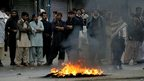 Pakistani Shia Muslims burn tyres in protest at the bombings in Quetta on 11/1/13
