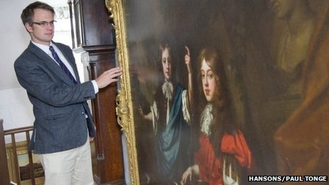 Charles Hanson with a painting thought to date back to 1670