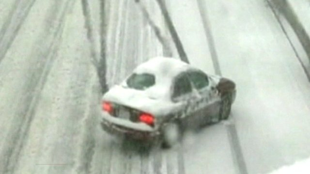 Car sliding on snowy road