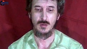 A file handout still frame released on October 4, 2012 by the SITE Monitoring Service shows French secret agent Denis Allex held hostage in Somalia