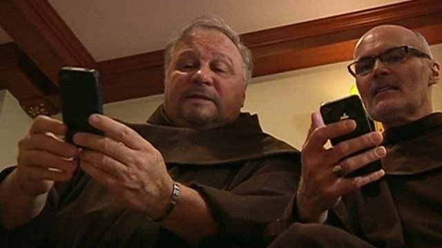 Friars with mobile phones