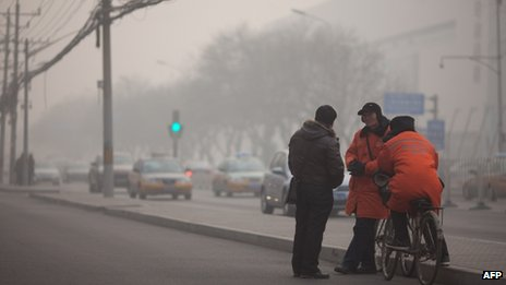 Parking attendants in Beijing on 12 January.