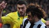 Fabricio Coloccini (middle) tacjkles Norwich midfielder Robert Snodgrass