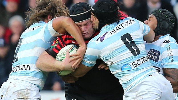 Saracens' former England prop Matt Stevens takes a double tackle from the Racing pack