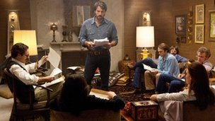 Ben Affleck with his cast in a scene from Argo