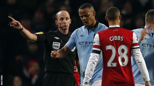 Vincent Kompany leaving the pitch after he was sent off by Mike Dean