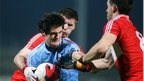 Chrissy McKaigue of UUJ comes under pressure from PJ McCloskey and Blain Gormley during Derry's 1-13 to 0-06 win