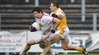 Sean Cavanagh attempts to get away from Antrim opponent Tony Scullion during Tyrone's 2-13 to 1-07 win at Casement Park