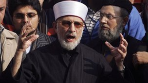 Muhammad Tahirul Qadri, leader of the Mihaj-ul-Quran movement, speaks before a protest march from Lahore to Islamabad