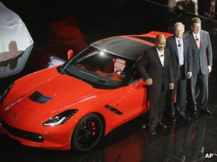 From left, General Motors vice president of global design, Ed Welburn, chief Corvette engineer Tadge Juechter and president of General Motors North America, Mark Reuss stand next to the redesigned Corvette Stingray, Sunday, 13 Jan, 2013