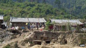 Bomb shelters built by Kachin refugees, at the Je Yang IDP camp, near Laiza, Burma, on 4 January 2013