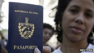 Cuban woman shows her new passport