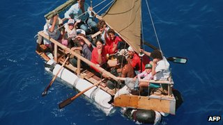 Cubans aboard a homemade raft being picked up by US Coast Guard in 1994
