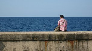 Man sits on the Havana seafront